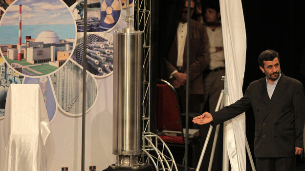 April 2010: Iranian President Mahmoud Ahmadinejad unveils a sample of the third generation centrifuge for uranium enrichment during a ceremony in Tehran on April 9, 2010. Iran says its nuclear ambitions are peaceful.