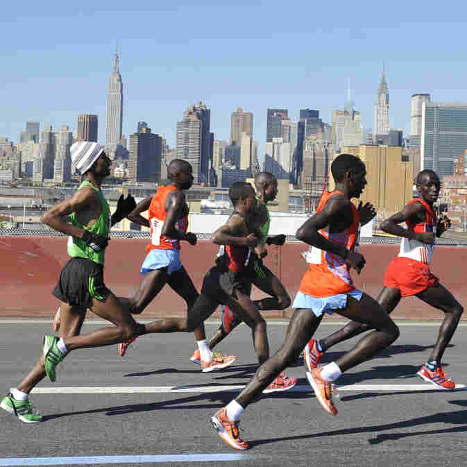 The men's leaders in the New York City Marathon cross the Pulaski Bridge running toward the borough of Queens on Sunday. The winner, Geoffrey Mutai, of Kenya, is at center rear, in green.