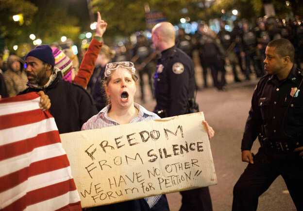 Amy Barnes protests as police move in to clear a downtown street during an Occupy Atlanta demonstration the first weekend in November.