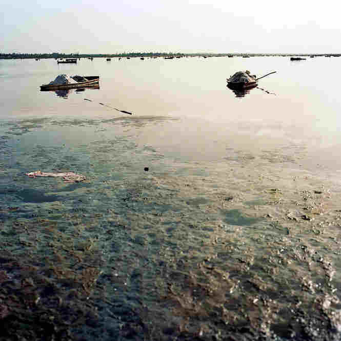 At Lake Rose, Senegal, salt is dredged from the bottom of the lake and piled into boats. The boats are then dragged ashore just before the weight of their load makes them sink.