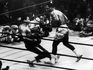 Muhammad Ali (right) goes down in t