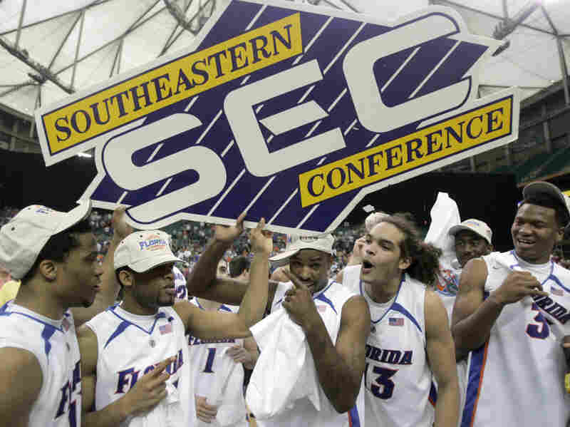 Florida players (from left) Taurean Green, Corey Brewer, Walter Hodge, Joakim Noah and Marreese Speights hold up the Southeastern Conference sign after defeating Arkansas in the SEC basketball tournament championship game at the Georgia Dome in Atlanta in 2007.