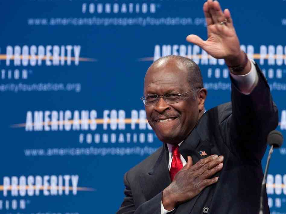 US Republican presidential hopeful Herman Cain arrives to address the 'Defending The American Dream Summit' organized by the conservative Americans For Prosperity (AFP) foundation in Washington on Nov. 4, 2011.