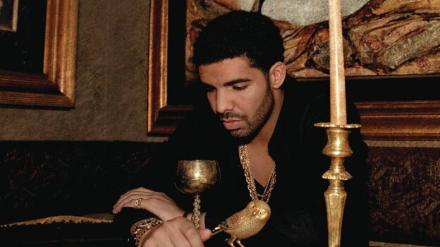 Drake, brooding, on the cover of Take Care.