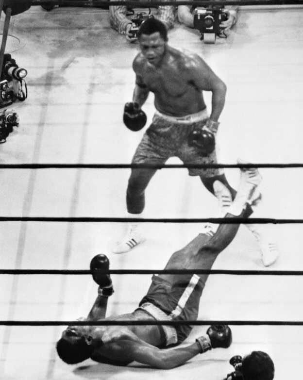 """Down goes Ali: In the """"Fight of the Century,"""" on March 8, 1971, in Madison Square Garden, heavyweight champion Joe Frazier put Muhammad Ali on the canvas with a hard left hook. Frazier died Monday."""