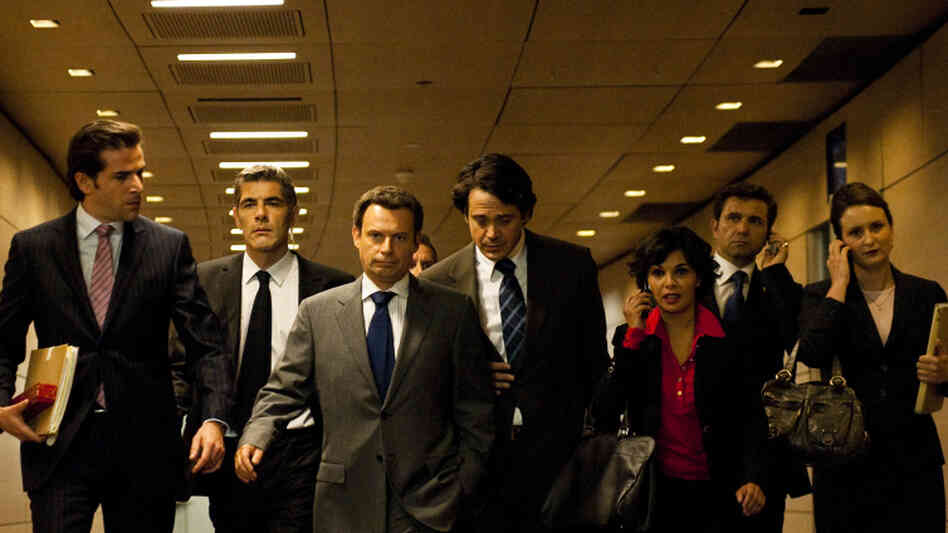 Ruthless Peuple: Denis Podalydès (third from left) portrays a scheming Nicolas Sarkozy in The Conquest, a drama about the French president's rise to power.