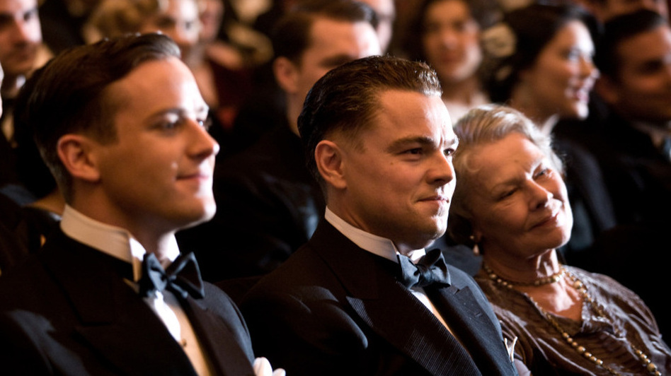 Domestic Asset: Armie Hammer's Clyde Tolson (left, with DiCaprio and Judi Dench as Hoover's mother, Annie) is an unexpectedly sympathetic presence in an otherwise unconvincing film. (Warner Bros. Pictures)