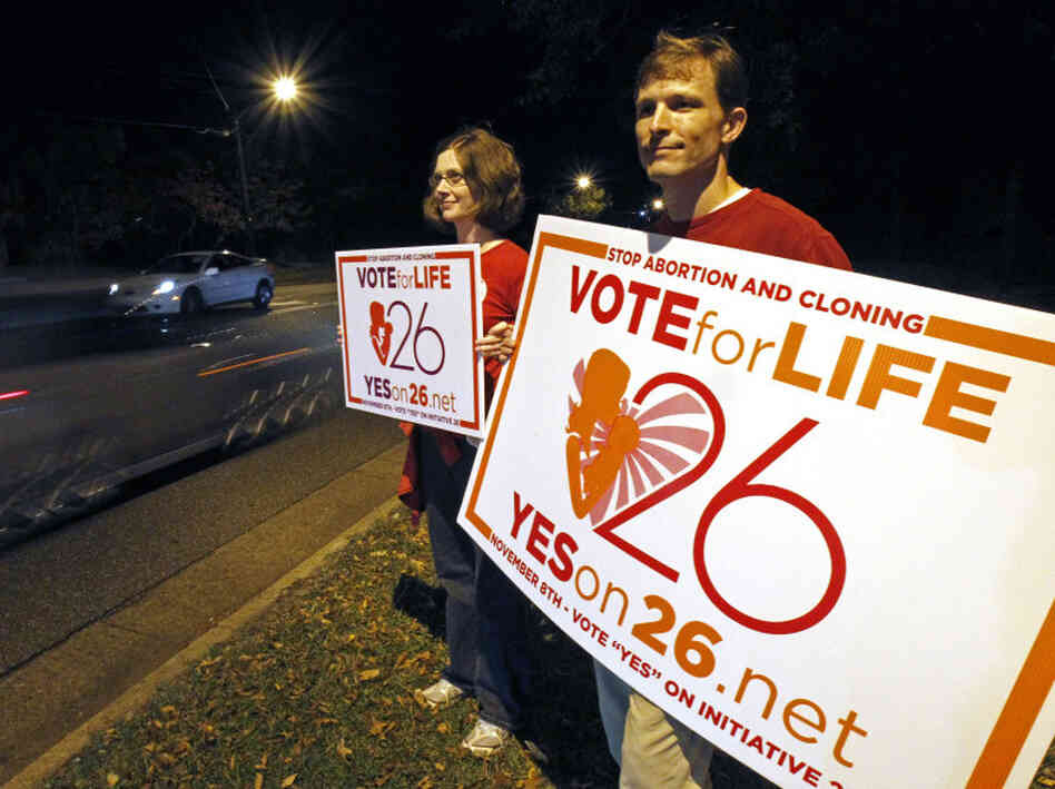 "Adam Browne, right and wife Debbie show support for the Mississippi ""personhood"" amendment,Tuesday, Nov. 8, 2011 in Jackson, Miss."