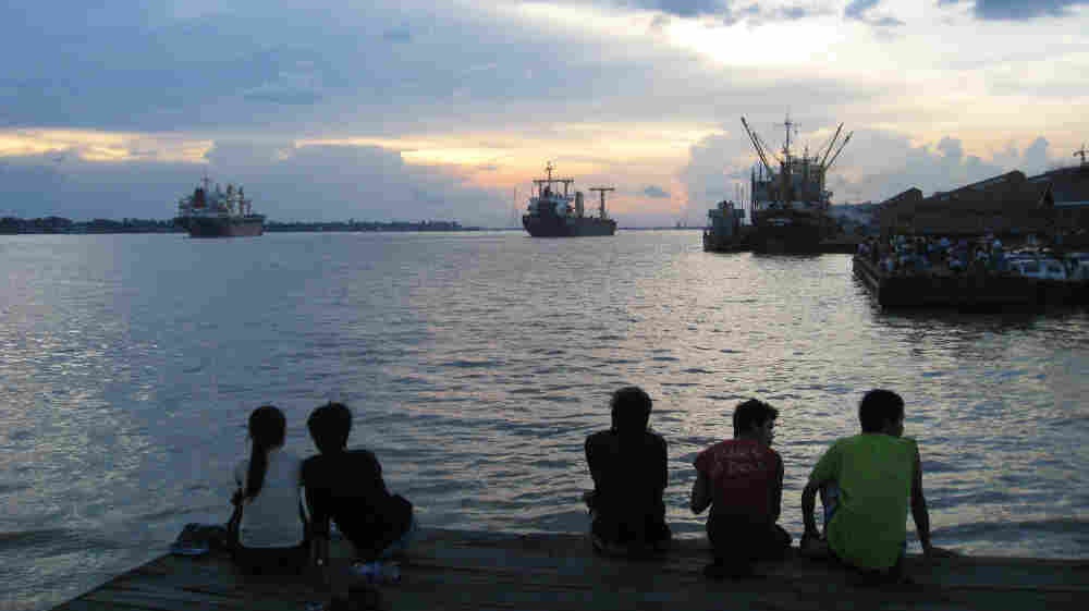 Yangon residents enjoy the sunset on the city's river. For decades, the Southeast Asian nation of Myanmar has suffered under a repressive military rule. But a new government installed in March says it's sincere about reform.