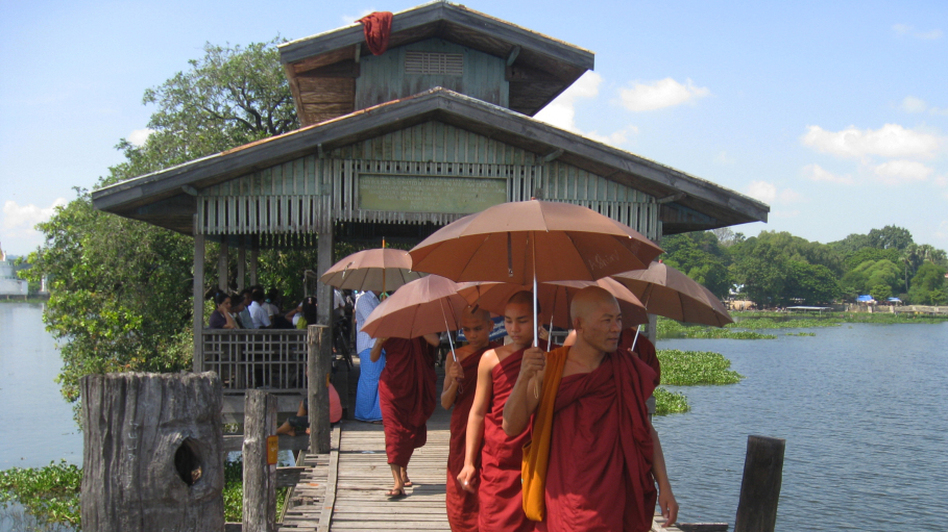 In largely Buddhist Myanmar, monks occupy a revered position in society and have often led anti-government protests. Here, monks walk along the U Bein Bridge in Amarapura, a former capital located just outside Mandalay.