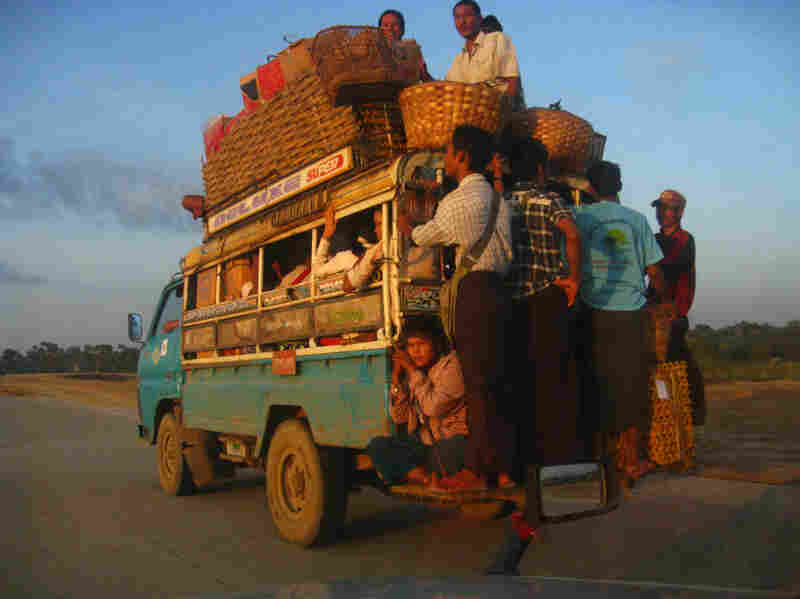 Outside Mandalay, ordinary people crowd onto the most common form of transportation in Myanmar — private bus.