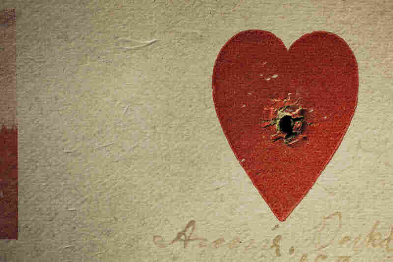 One of Annie Oakley's most popular stunts was shooting through the center of a small heart on a card.