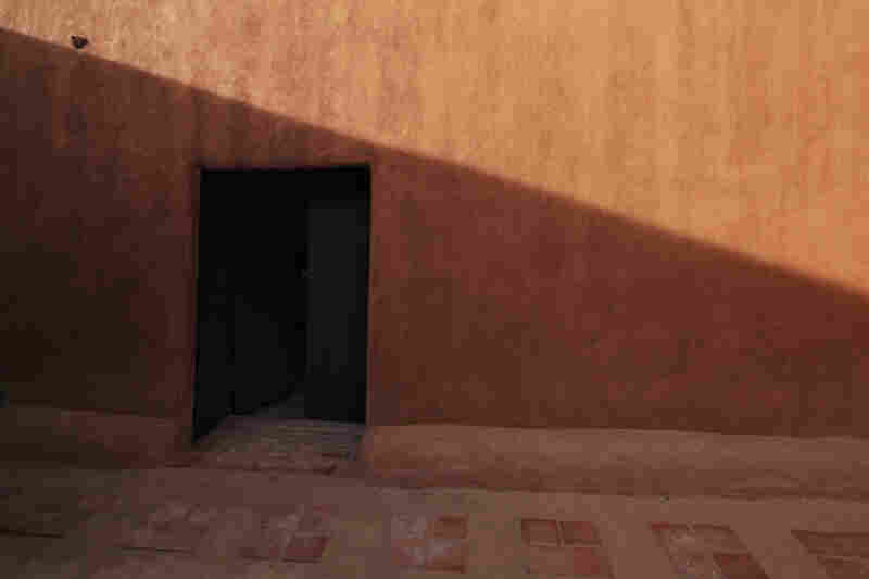 The door in the adobe patio wall is what first attracted Georgia O'Keeffe to this house in Abiquiu, N.M.