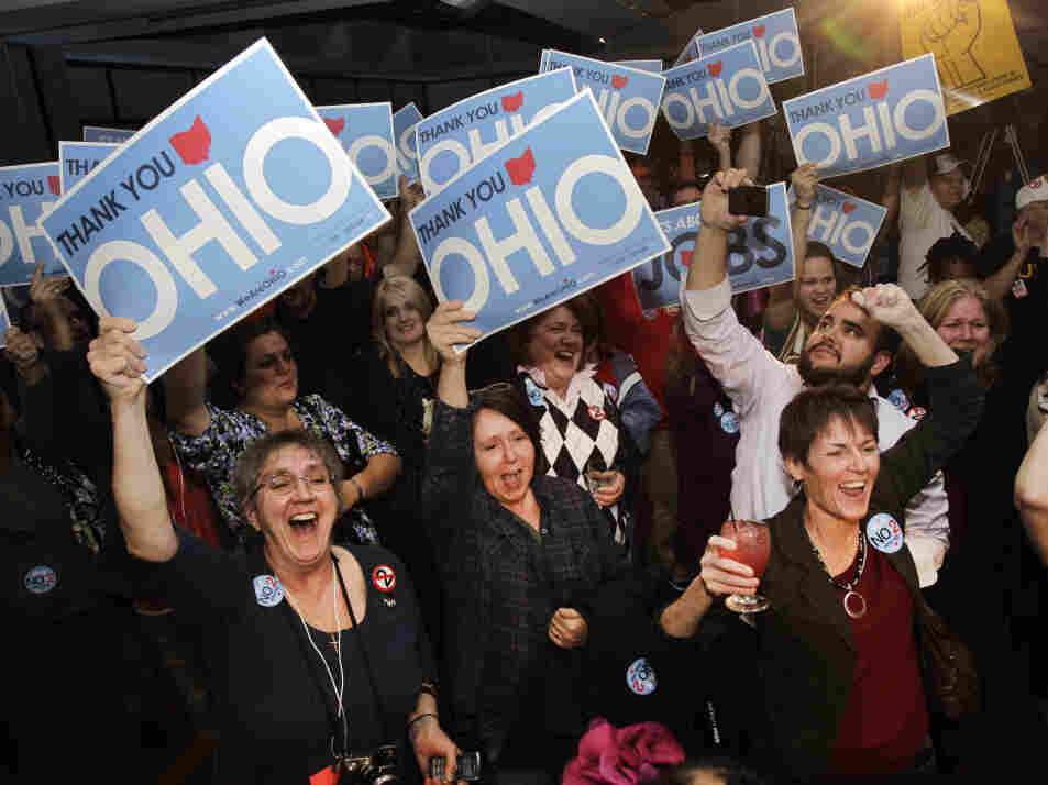 Opponents of a law limiting collective-bargaining rights cheer in Cleveland as they hear election results sounding the defeat of the measure in the Ohio general election on Tuesday.