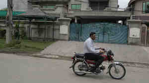 A man rides past the house of kidnapped