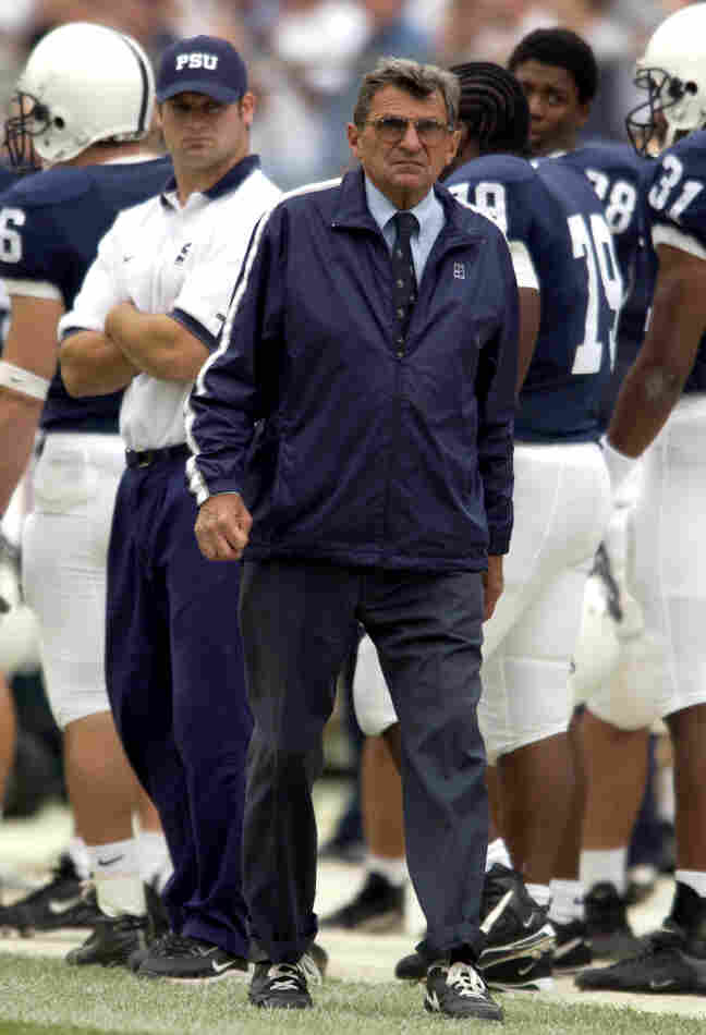 Penn State football coach Joe Paterno was fired Wednesday by the university board. The coach is seen here during the 2002 season, several months after a graduate assistant informed him of seeing alleged sexual abuse in a locker room shower.