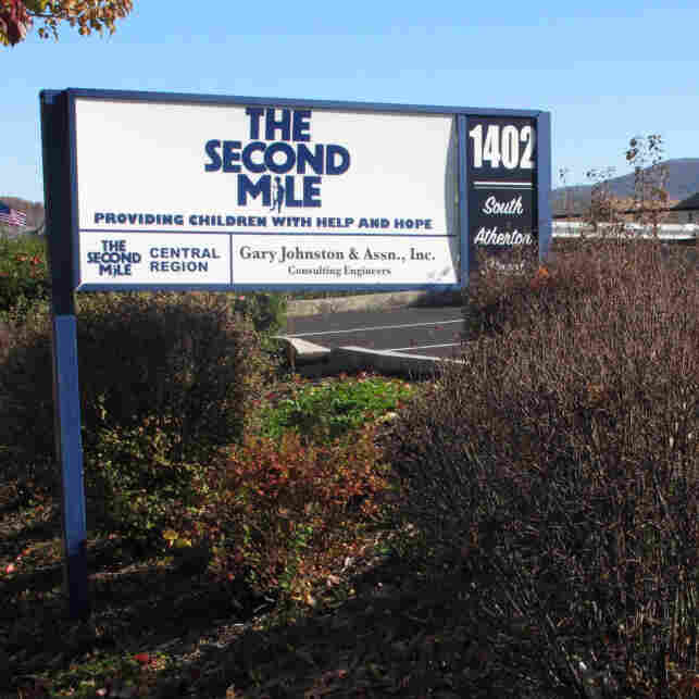 A sign for The Second Mile charity is seen outside the organization's headquarters in State College, Pa., on Saturday Nov. 2, 2011.
