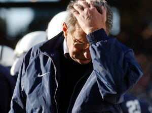 Penn State football coach Joe Paterno pauses on the sidelines during a game against Northwestern. Paterno's former assistant coach Jerry Sandusky has been accused of sexual abuse