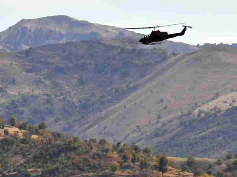 A Turkish military helicopter flies in Yemisli, Hakkari province near the Iraqi border in southeastern Turkey, on Oct. 22.