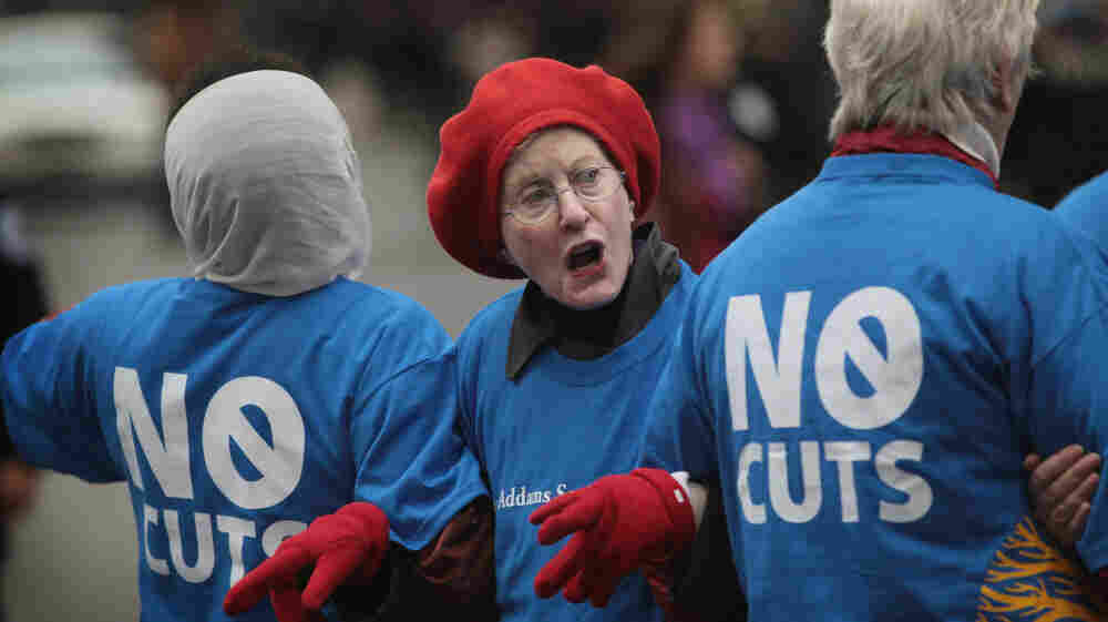 Judy Moses, 71, prepares to be arrested during an Occupy Chicago protest against cuts to federal safety net programs, including Social Security, Medicare and Medicaid, on Monday.