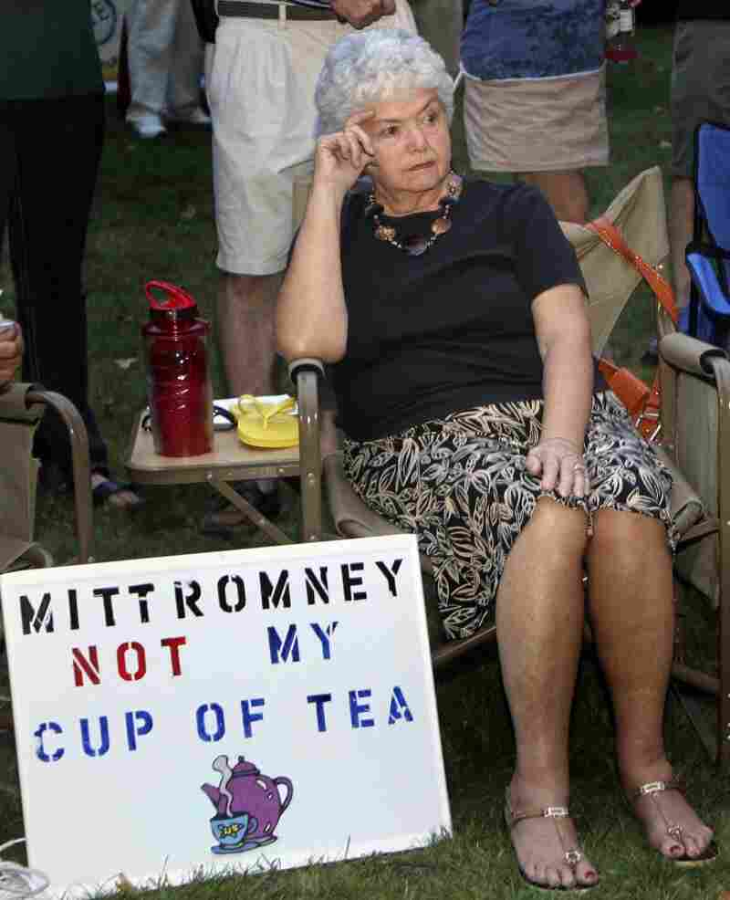 In this Sept. 4 file photo, Ann Kalifrath listens to Republican presidential candidate and former Massachusetts Gov. Mitt Romney speak at a Tea Party Express rally in Concord, N.H.