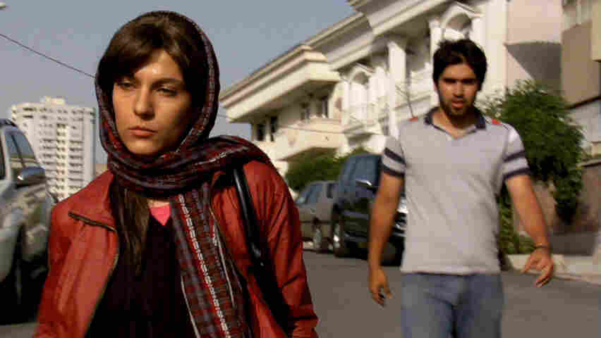 In Hossein Keshavarz's debut film, Katie (Tahereh Azadi, left) settles for an unrequited admirer after her relationship with a married man crumbles.