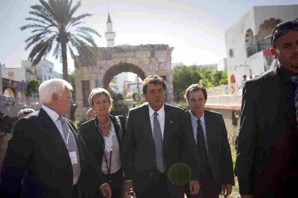French State Minister for Foreign Trade Pierre Lellouche (center) led a delegation of French business leaders to Tripoli in October. European and Turkish companies have been active in pursuing contracts with the new Libyan government.