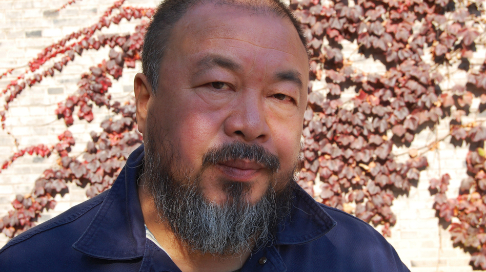 Outspoken Chinese artist and activist Ai Weiwei (shown inside his compound on the outskirts of Beijing) was detained by the government for nearly three months. Now, the government says he owes $2.4 million in taxes and fines. Supporters are sending him money, raising nearly $1 million so far. (NPR)