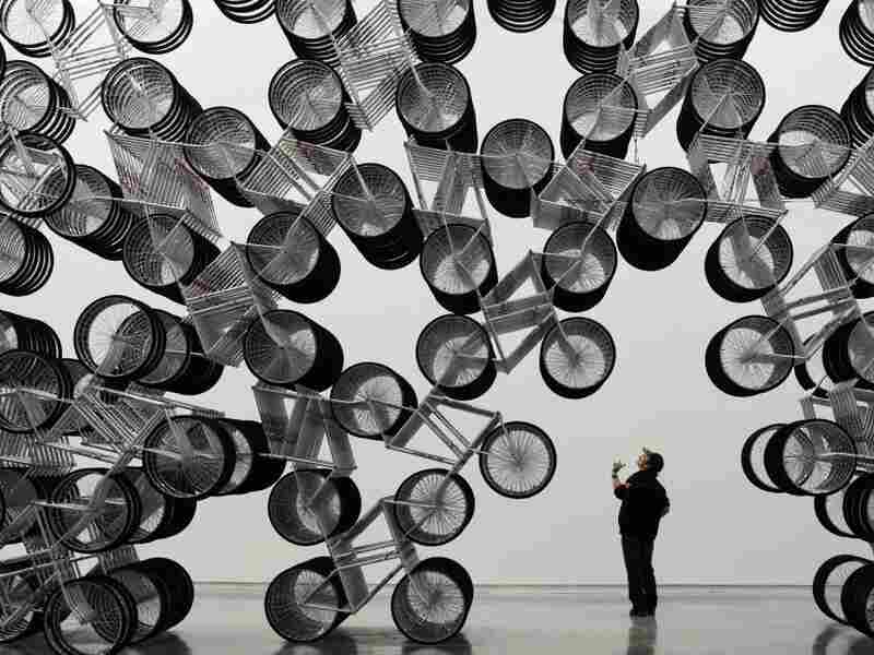A man admires Forever Bicycles, a work by Ai Weiwei, at the Taipei Fine Art Museum last month.