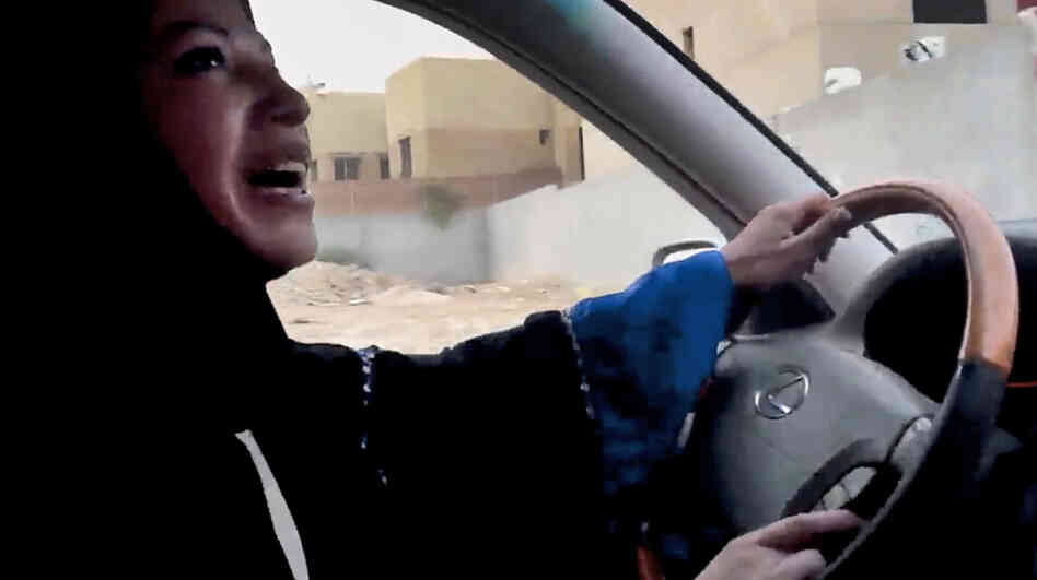 A Saudi woman drives a car in Riyadh in June as part of a campaign to defy the kingdom's ban on women driving. The image is from a video released by Change.org.