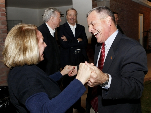 Apparent winner of Arizona state senate recall election, Jerry Lewis, with his sister, Pam Lewis Wessner, Tuesday, Nov. 8, 2011. (AP)