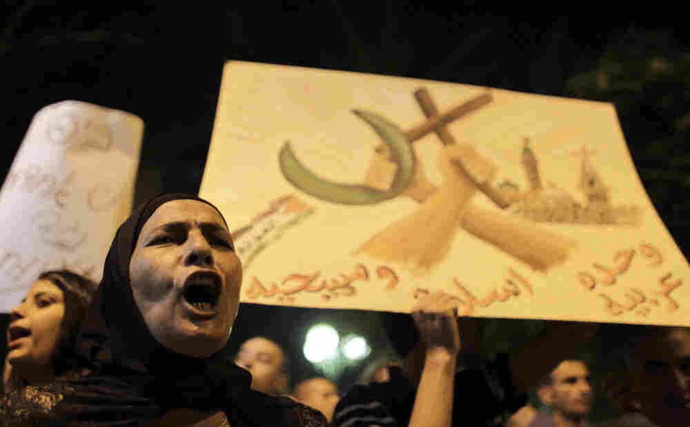A woman shouts slogans during a demonstration against the desecration of headstones at a Muslim and Christian cemetery in Jaffa, Israel, last month. A few dozen Israelis and Palestinians turned out in a show of protest against recent attacks.