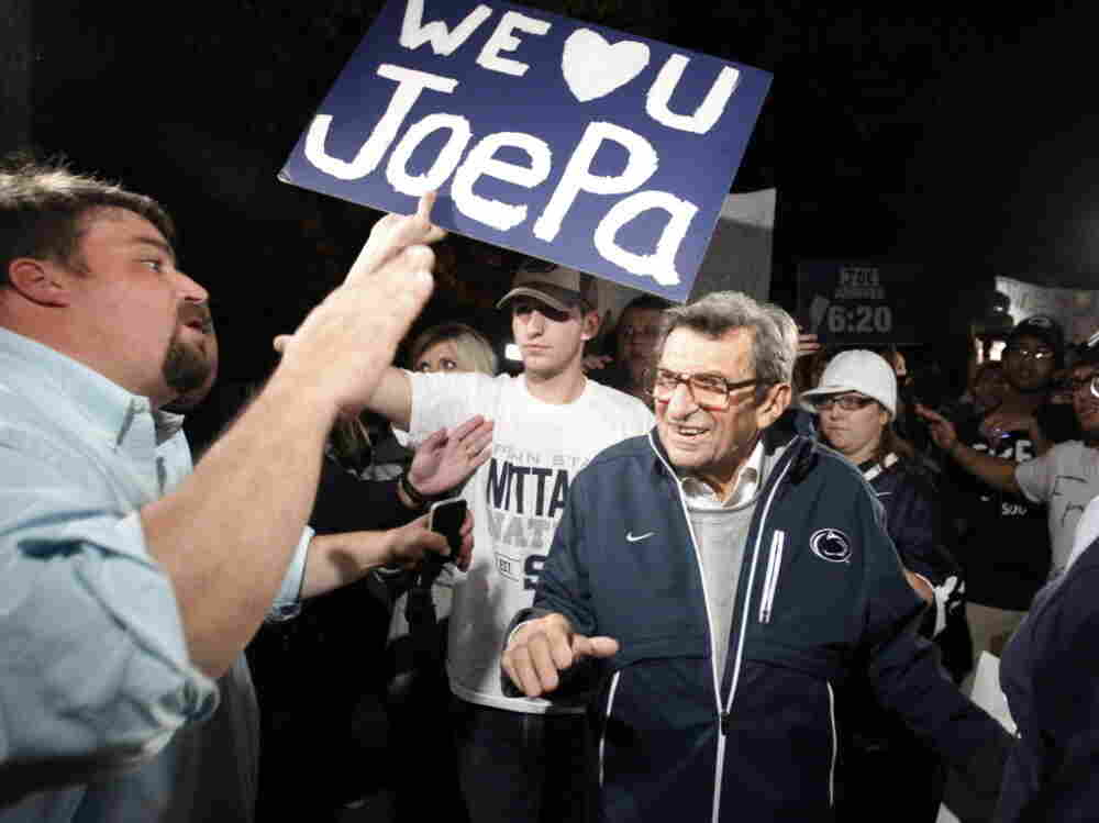 Scott Paterno, left, greeted his father — Penn State football coach Joe Paterno — as the coach arrived at his home, Tuesday evening in State College, Pa. Hundreds of students had gathered to show support for the coach.