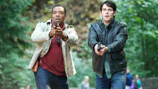 Russell Hornsby as Hank Griffin and David Giuntoli as Nick Burkhardt on NBC's Grimm.