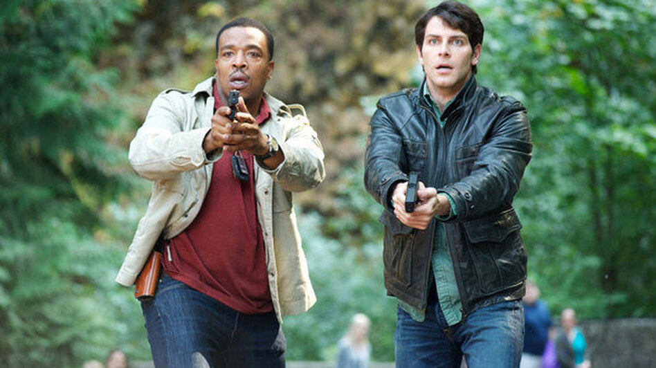 Russell Hornsby as Hank Griffin and David Giuntoli as Nick Burkhardt on NBC's <em>Grimm</em>.