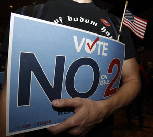A supporter of the initiative to repeal an anti-union bill holds his sign in Columbus, OH, Nov. 8, 2011,