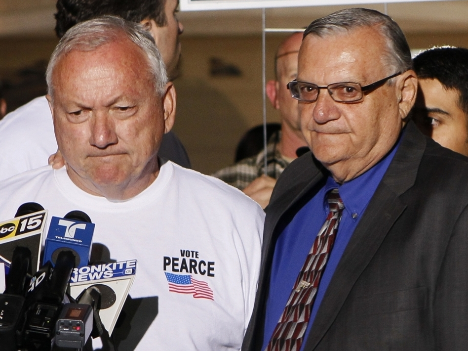 Recalled Arizona State Sen. Russell Pearce with Maricopa County Sheriff Joe Arpaio, in Mesa, AZ, Tuesday, Nov. 8, 2011.  (AP)