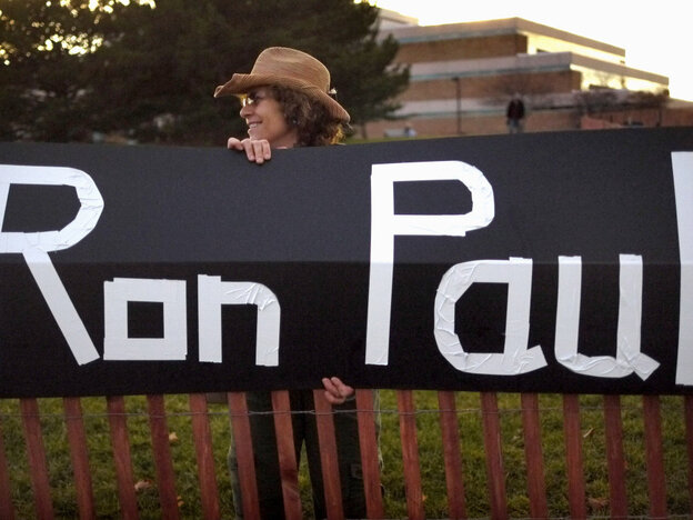Sue McQueen displays her support for GOP presidential candidate Rep. Ron Paul outside the debate venue, Rochester, Mich., Nov. 9, 2011.