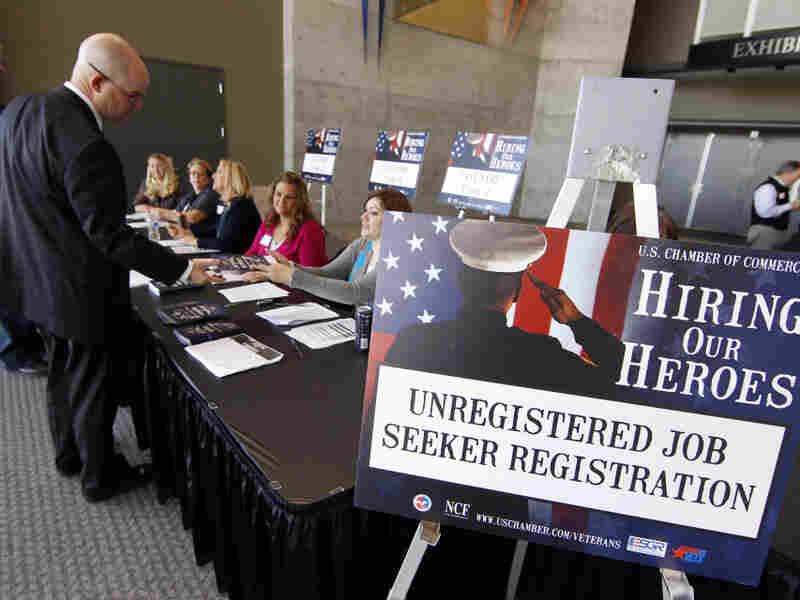 """Veterans register for the """"Hiring Our Heroes"""" job fair on Nov. 4 at the South Towne Expo Center in Sandy, Utah. Some 240,000 veterans who served in Iraq and Afghanistan are out of work."""