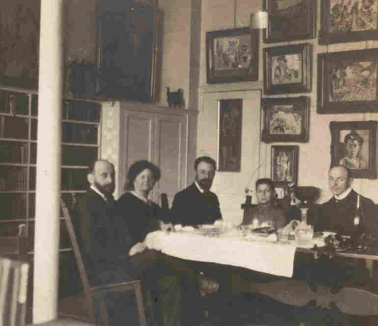 Artists Henri Matisse (center) and Hans Purrmann (far right) dine with Michael and Sarah Stein (left) and their son Allan, circa 1907, at Michael and Sarah's home at 58 Rue Madame.
