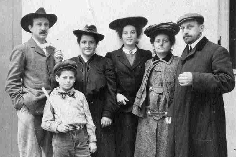 The Stein family poses for a photograph in the courtyard at 27 Rue de Fleurus, circa 1905. From right: Michael and Sarah Stein, Theresa Ehrman, a family friend of Michael and Sarah's who came with them to Paris as a teenager; sister and brother Gertrude and Leo Stein. Michael and Sarah's son Allan stands in front.