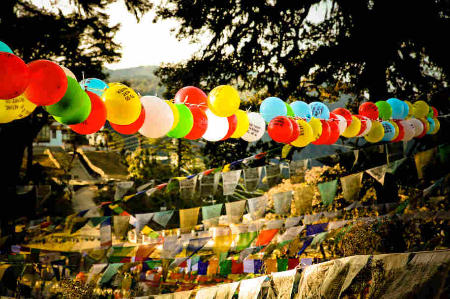 On the final night of the project, Harris strung 117 balloons with thousands of prayer flags in a sacred mountain pass.