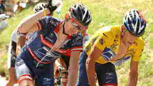 Floyd Landis, left, and then-teammate Lance Armstrong during the 2004 Tour de France.