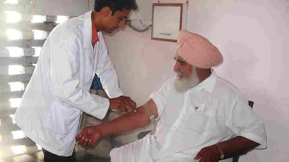 In a Healthpoint clinic in the village of Mallan in Punjab, India, lab technician Navdeep Sharma draws Suba Singh's blood sample. Part of Healthpoint's business plan is to offer cheap diagnostic tests at its clinics. Diagnosing and treating people in a single visit is one key to delivering affordable health care.