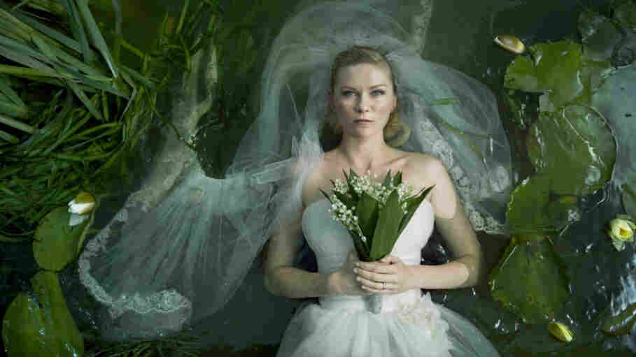 It's Oddly Easy Being Blue: Depressive newlywed Justine (Kirsten Dunst) finds herself oddly well equipped to face the end of humankind in Lars von Trier's  Melancholia.