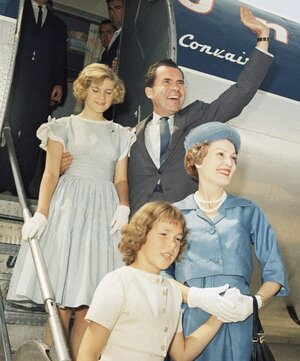 Then-Vice President Richard Nixon arrives in Chicago for the 1960 Republican National Convention with his wife, Pat, and his daughters Patricia (left) and Julie (right). Mrs. Nixon was known for her ever-present smile and well-groomed appearance.