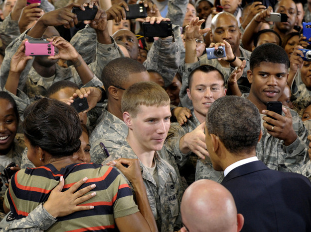 President Obama and first lady Michelle Obama meet troops during a stop at Joint Base Langley-Eustis in Hampton, Va, on Oct. 19. Obama says service members who fought for their country shouldn't have to fight for jobs when they come home.