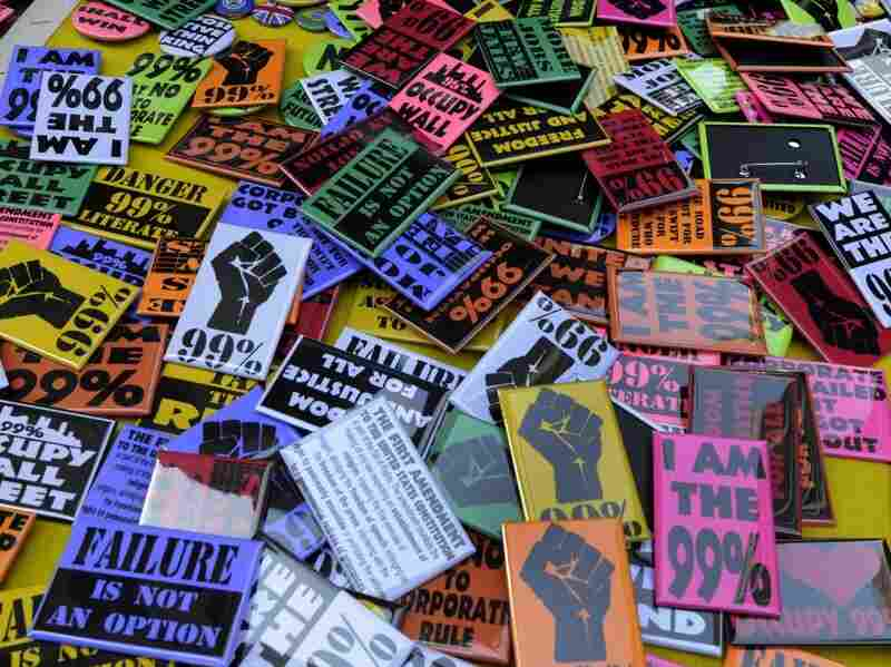 A selection of pins are shown at the 'Occupy Wall Street' protest in New York on Nov. 8, 2011.