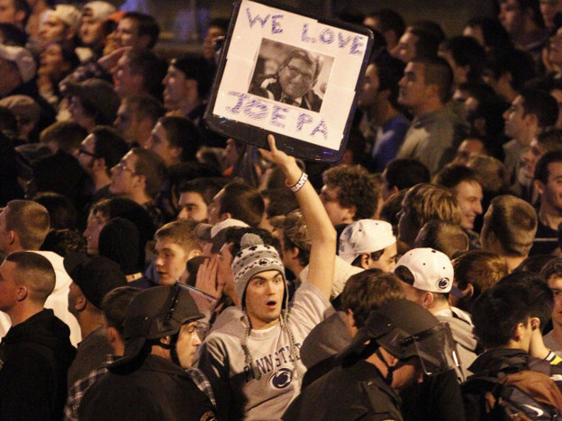 Scores of students gathered late Wednesday near the Penn State campus in State College, Pa., to protest the firing of football coach Joe Paterno. Dozens of police officers wearing helmets and carrying pepper spray were called in to control the crowd. (AP)