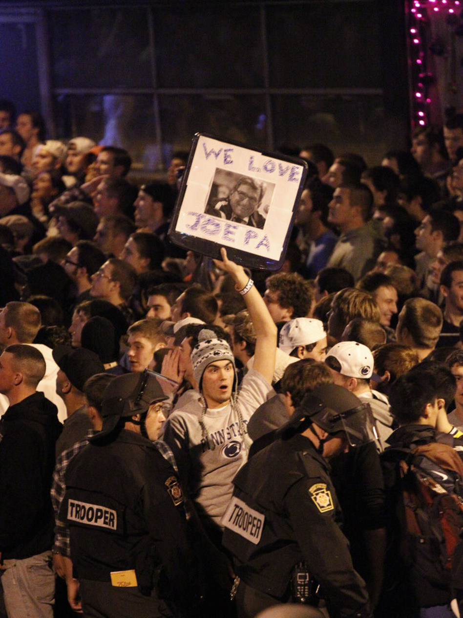 Scores of students gathered late Wednesday near the Penn State campus in State College, Pa., to protest the firing of football coach Joe Paterno. Dozens of police officers wearing helmets and carrying pepper spray were called in to control the crowd.